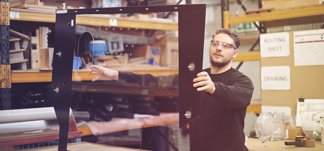 man holding up a plastic frame