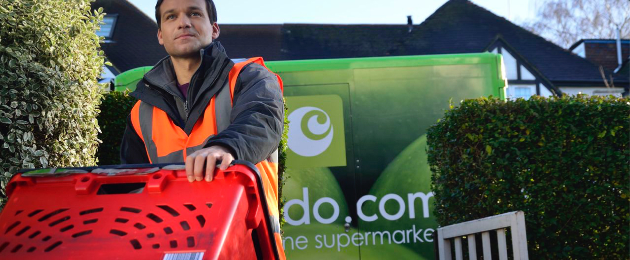 supermarket delivery man carrying a box
